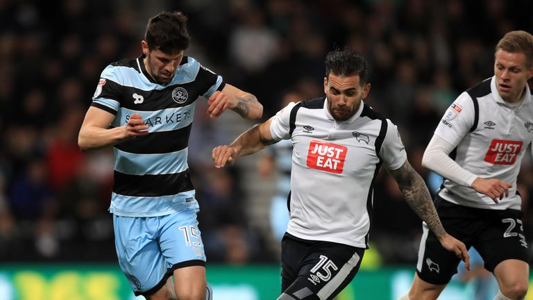 Queens Park Rangers' Pawel Wszolek (left) and Derby County's Bradley Johnson battle for the ball