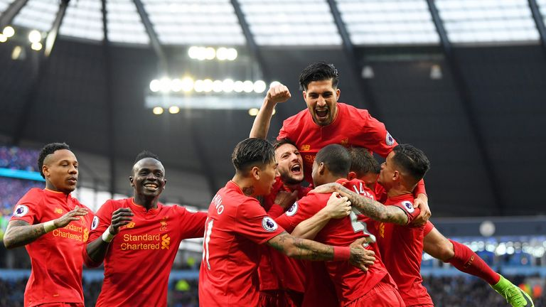 James Milner is surrounded by his Liverpool team-mates after scoring from the penalty spot