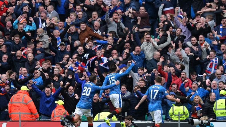 Rangers players celebrate in front of their fans at Celtic Park after Hill's late equaliser