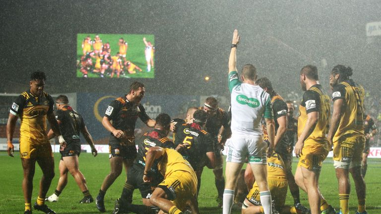 The Chiefs players celebrate Brodie Retallick's try