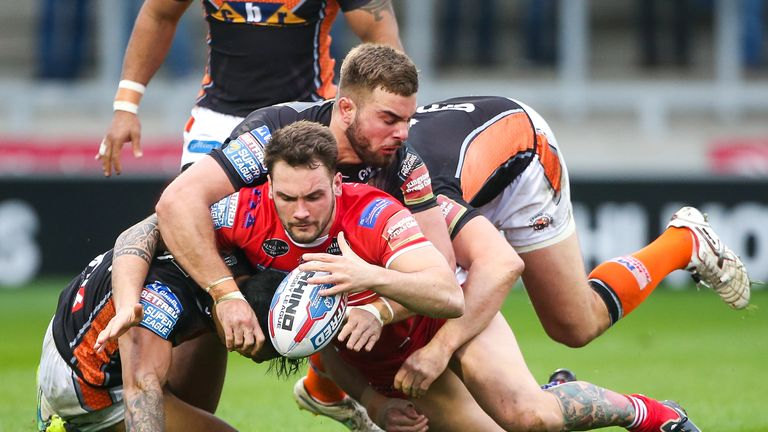 George Griffin is tackled by Castleford's Ben Roberts, Andy Lynch and Mike McMeeken
