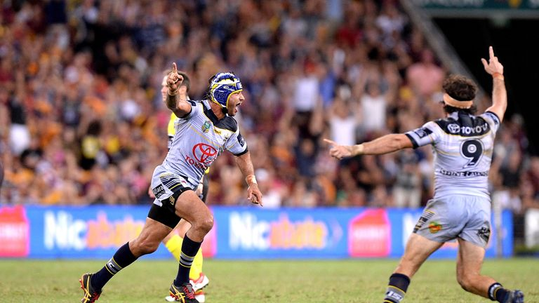 Johnathan Thurston celebrates after kicking the winning field goal against Brisbane