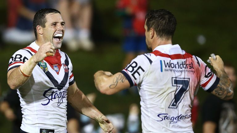 Michael Gordon (left) celebrates scoring a try against Penrith with team-mate Mitchell Pearce