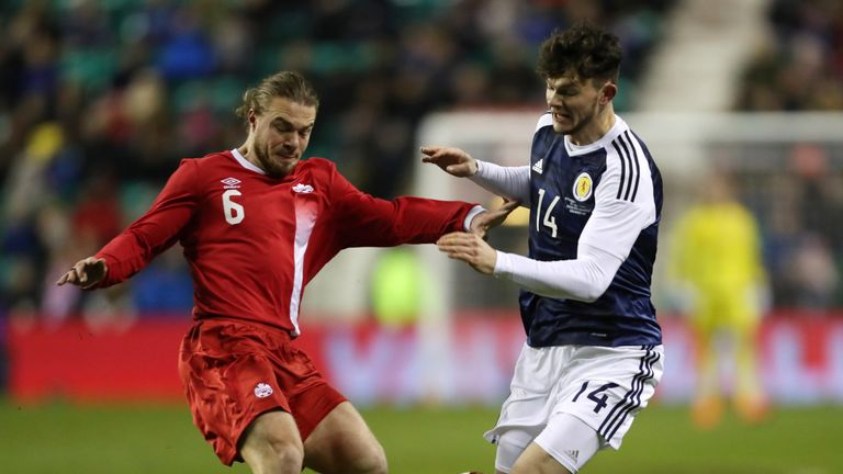 Samuel Piette of Canada vies with Oliver Burke of Scotland during the friendly