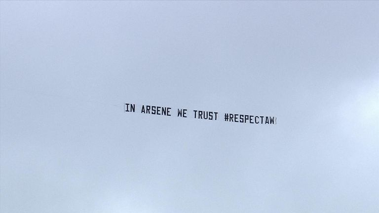 ... while another banner supported Wenger