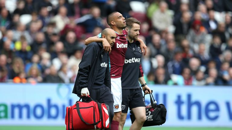 Winston Reid limps off against Leicester