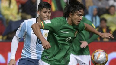 Bolivia forward Marcelo Martins (R) controls the ball