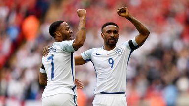 Jermain Defoe celebrates with Raheem Sterling after scoring on his return to the England side