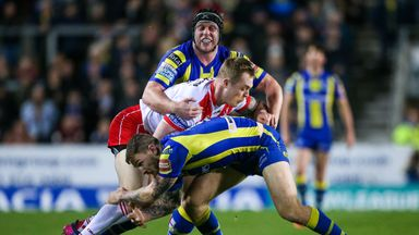 St Helens' Adam Swift is tackled by Warrington's Daryl Clark and Chris Hill.
