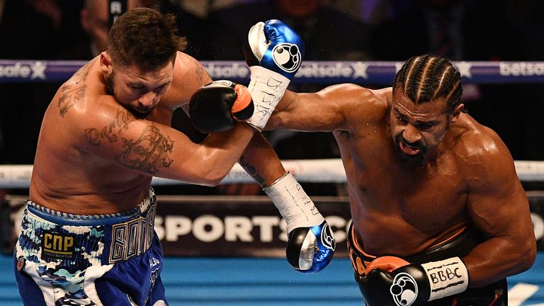 British boxer David Haye (R) unleashes a right cross against compatriot Tony Bellew (L) during their heavyweight boxing match at the O2 Arena in London on