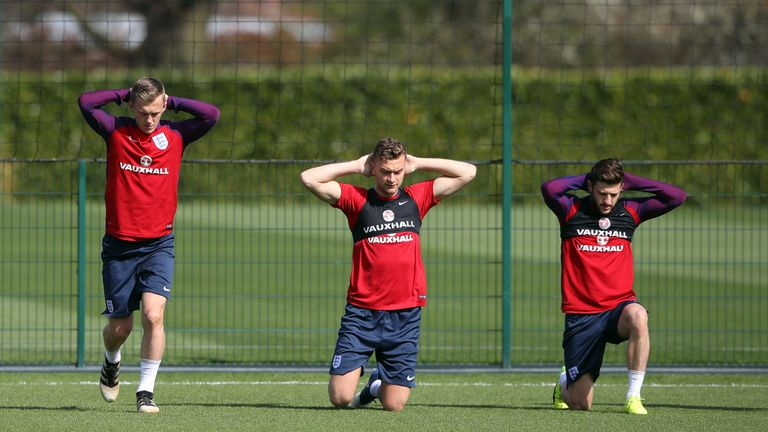 England's (from left to right) James Ward-Prowse, Ben Gibson and Adam Lallana during the training session at Enfield Training Ground, London.