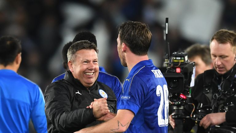LEICESTER, ENGLAND - MARCH 14:  Craig Shakespeare the interim Manager of Leicester City and Christian Fuchs of Leicester City celebrate their team's 3-2 ag