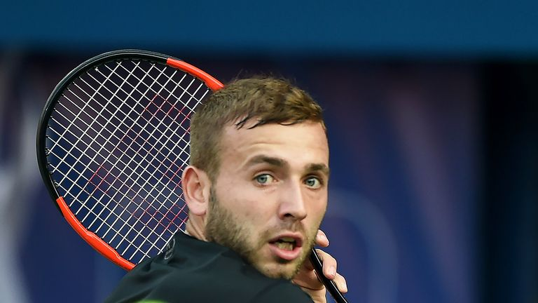 Dan Evans plays a backhand during his second round match against Gael Monfils at the Dubai Tennis Championships
