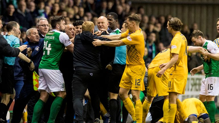 Morton manager Jim Duffy and Hibernian manager Neil Lennon are involved in a confrontation before full-time.