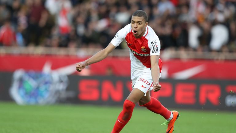 Monaco's French forward Kylian Mbappe celebrates after scoring a goal during the French L1 football match Monaco (ASM) vs Bordeaux (GB) on March 11, 2017 a