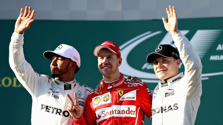 Sebastian Vettel celebrates his win on the podium with second placed Lewis Hamilton and third place Valteri Bottas