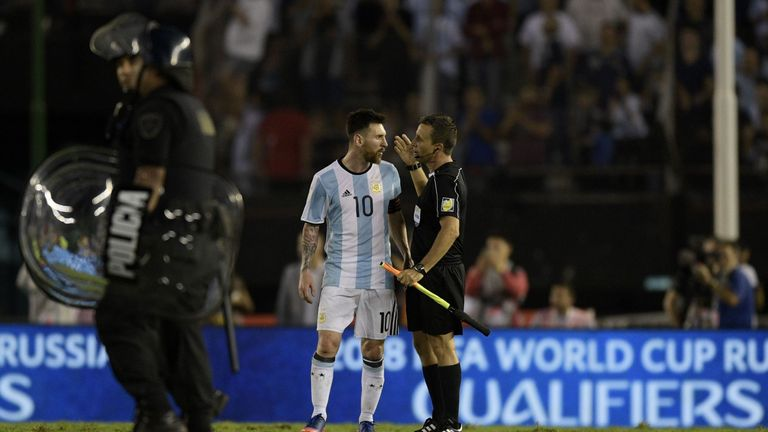 Argentina's Lionel Messi speaks with the linesman during their 2018 FIFA World Cup qualifier football match against Chile