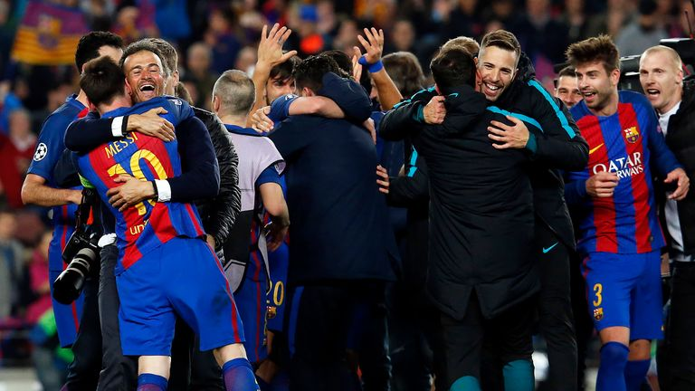 Luis Enrique and Lionel Messi embrace after the final whistle