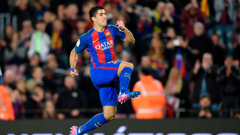 Luis Suarez celebrates after scoring Barca's third goal