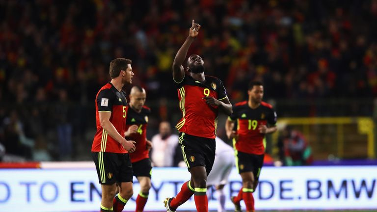BRUSSELS, BELGIUM - MARCH 25:  Romelu Lukaku of Belgium celebrates scoring his teams first goal of the game with team mates uring the FIFA 2018 World Cup G