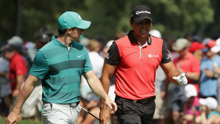 SPRINGFIELD, NJ - JULY 29: (L-R) Rory McIlroy of Northern Ireland and Jason Day of Australia walk off the fifth tee during the second round of the 2016 PGA