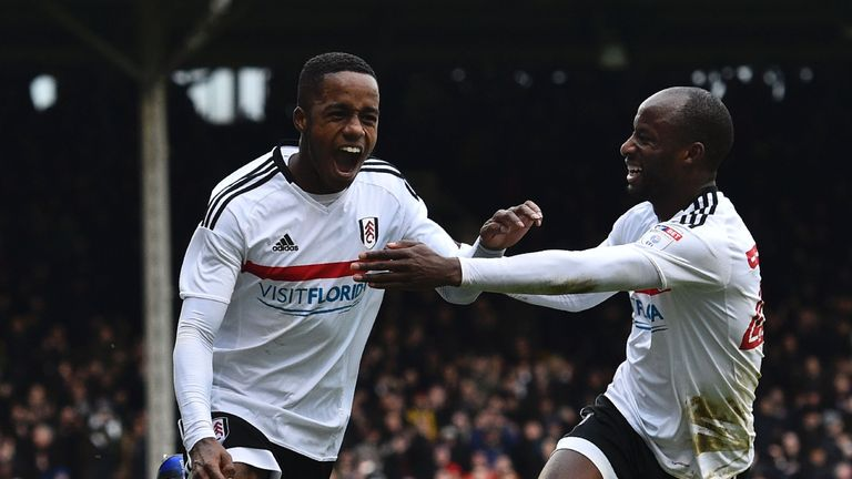 Fulham's English defender Ryan Sessegnon (L) celebrates scoring their third goal during the English FA Cup fourth round football match between Fulham and H