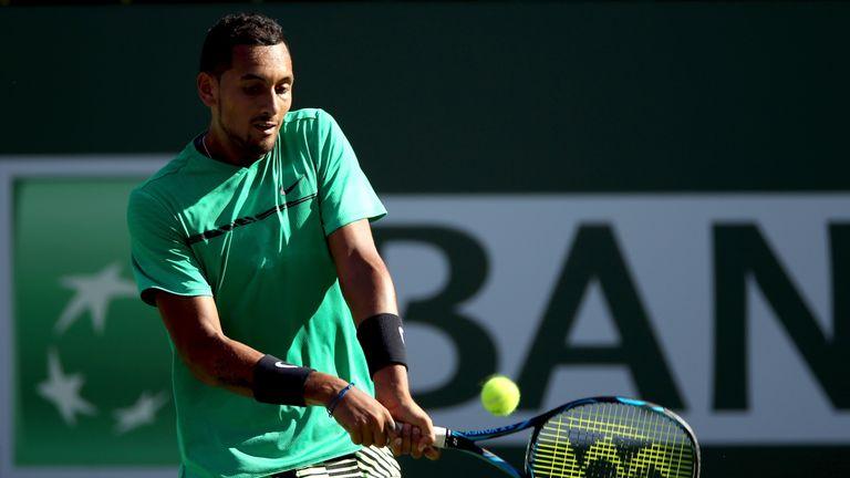 Nick Kyrgios of Australia returns a shot to Novak Djokovic of Serbia during the BNP Paribas Open at the Indian Wells