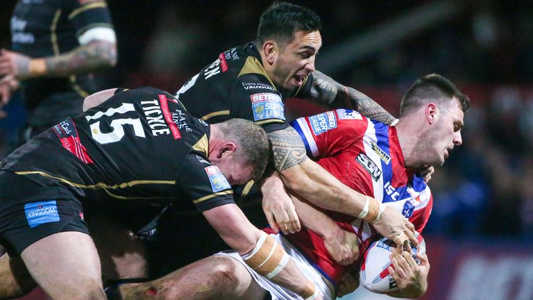 Wakefield's Joe Arundel is tackled by Leigh's Danny Tickle and Harrison Hansen.