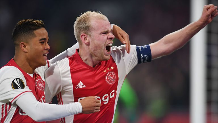 Ajax midfielder Davy Klaassen celebrates after scoring against Schalke