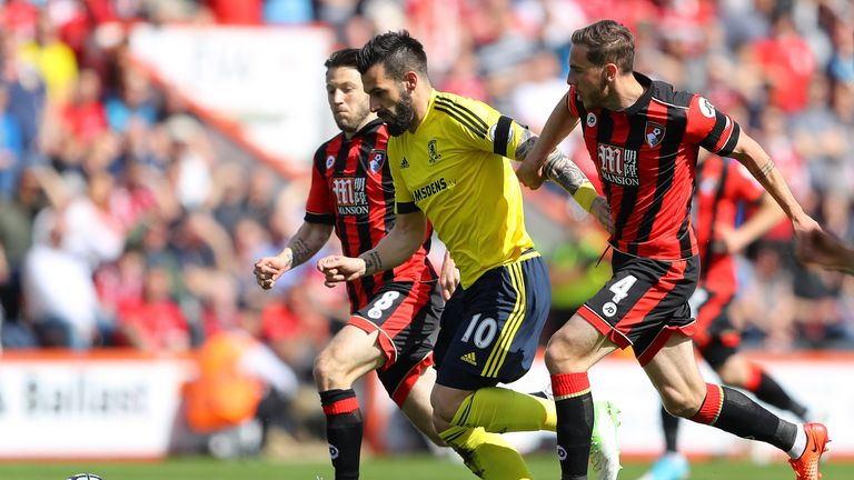 Alvaro Negredo is put under pressure by Harry Arter and Dan Gosling