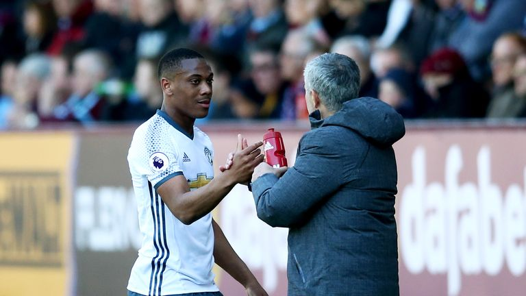 Jose Mourinho shakes hands with Anthony Martial as he is substituted against Burnley