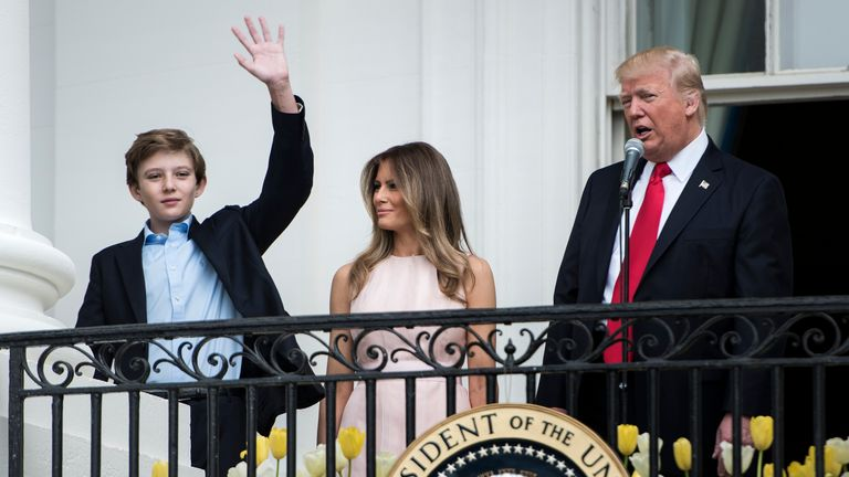 Barron Trump appears on the White House balcony before a kickabout in Arsenal colours later