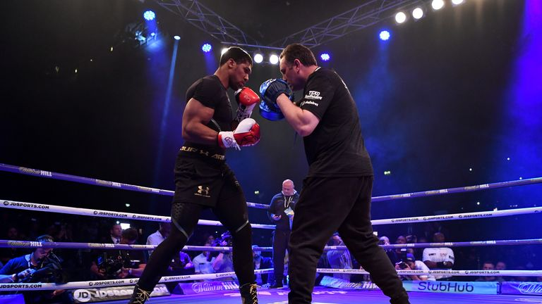 Joshua is put through his paces by trainer Rob McCracken
