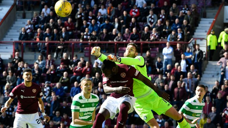 Celtic goalkeeper Craig Gordon punches clear