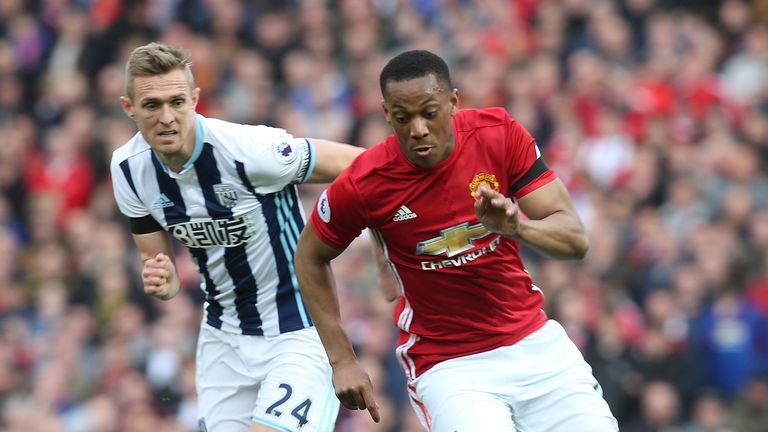 Manchester United striker Anthony Martial is challenged by West Bromwich Albion's Darren Fletcher