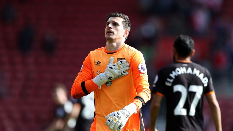 Jakupovic celebrates with fans after the match