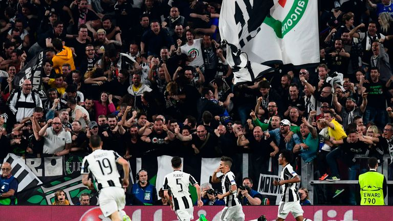 Dybala (2nd right) celebrates scoring against Barcelona