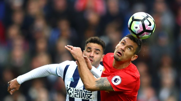 Dejan Lovren battles for possession with West Brom's Hal Robson-Kanu