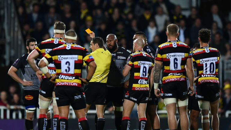 Mathieu Tanguy of La Rochelle is shown a yellow card by referee Andrew Brace