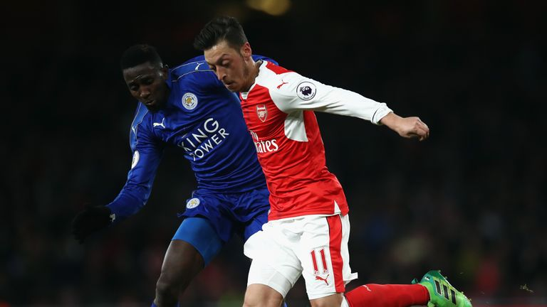 Mesut Ozil and Wilfred Ndidi tussle in midfield