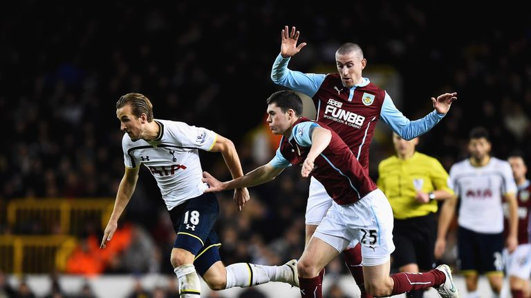 Michael Keane tries to stop Tottenham's Harry Kane in his tracks