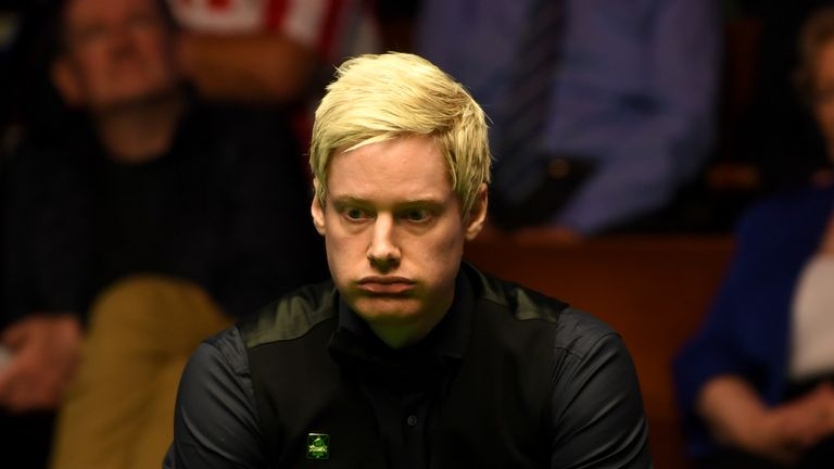 Neil Robertson closed out victory against Noppon Saengkham in Sheffield