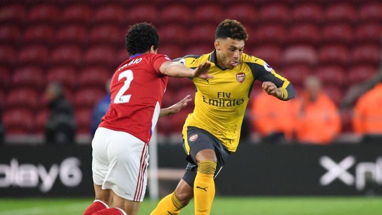 Alex Oxlade-Chamberlain takes on Middlesbrough's Fabio at the Riverside