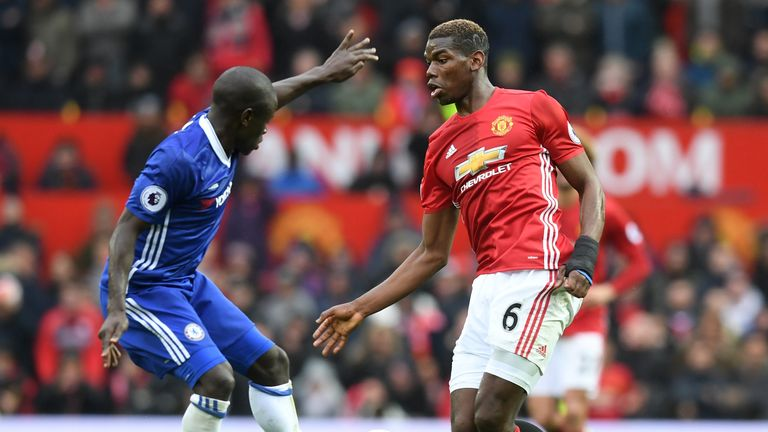 Paul Pogba takes on N'Golo Kante during Manchester United's clash with Chelsea