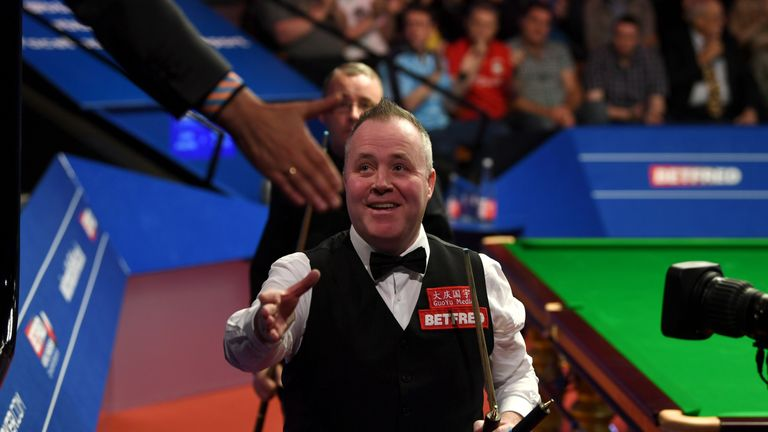 John Higgins celebrates after beating Martin Gould in Sheffield