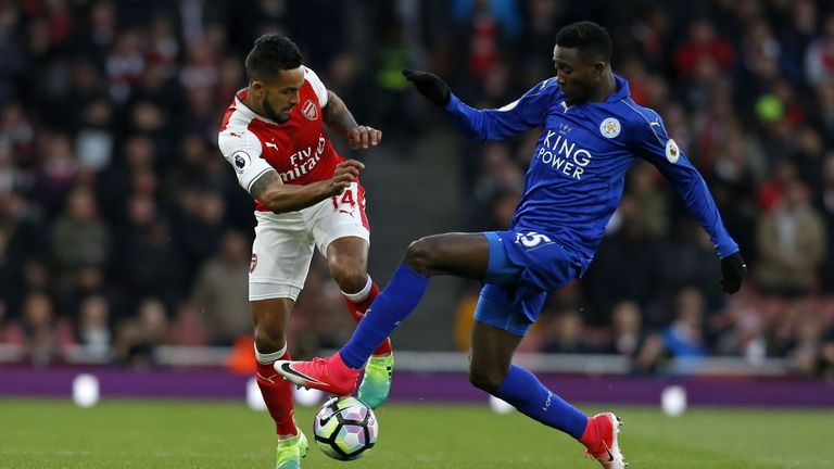 Wilfred Ndidi looks to steal the ball from Theo Walcott