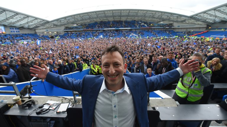 Brighton Chairman Tony Bloom celebrates the club's promotion