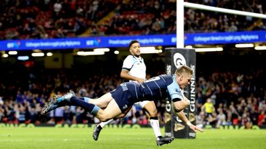 Gareth Anscombe dives over for a try for the Blues