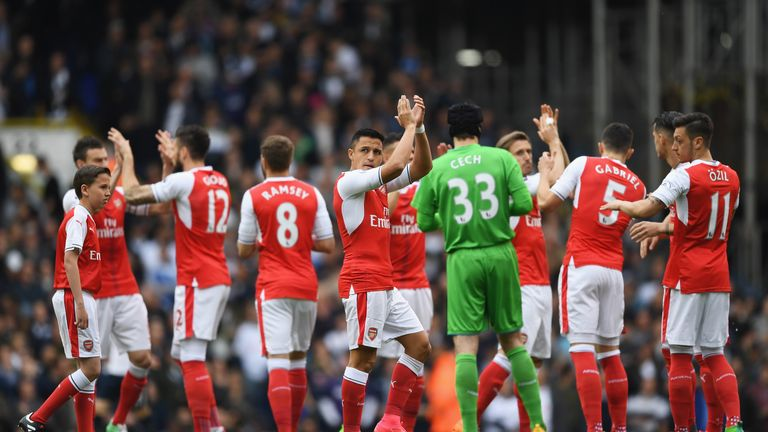 Alexis Sanchez of Arsenal shows appreciation to the fans prior to the Premier League match between Tottenham Hotspur and Arsenal