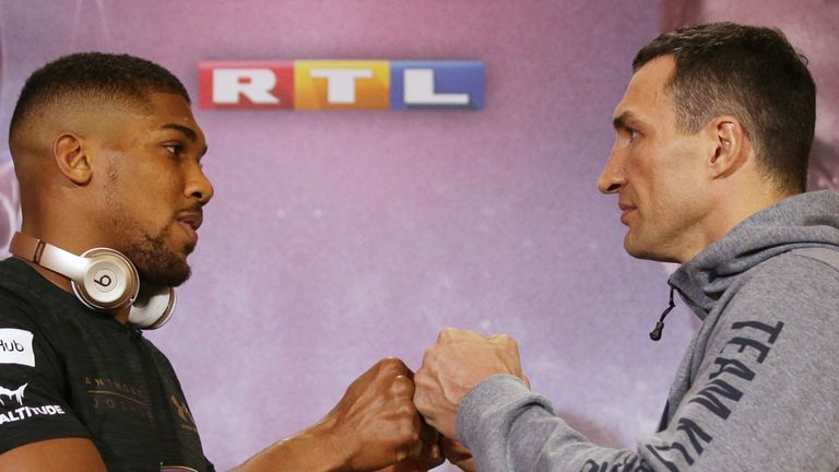 Britain's Anthony Joshua (L) poses by Ukraine's Wladimir Klitschko during a joint press conference at Sky broadcasting headquarters in west London on April